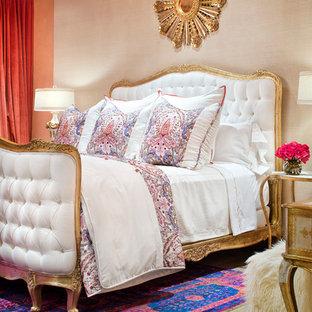Tuscan medium tone wood floor bedroom photo in Houston with beige walls