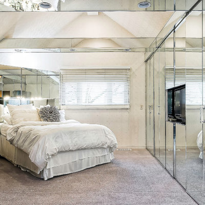 Example of a mid-sized trendy master carpeted and gray floor bedroom design in Columbus with white walls and no fireplace