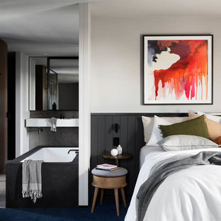 Design ideas for a large contemporary master bedroom in Melbourne with grey walls, ceramic floors, no fireplace and grey floor.
