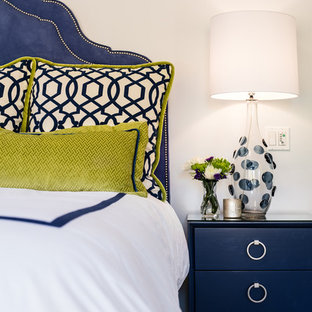 Example of a transitional master bedroom design in Santa Barbara with white walls