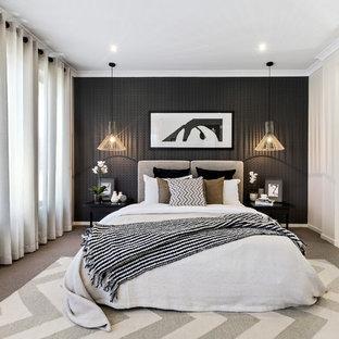 Foto di una camera matrimoniale minimal con pareti nere, moquette e nessun camino