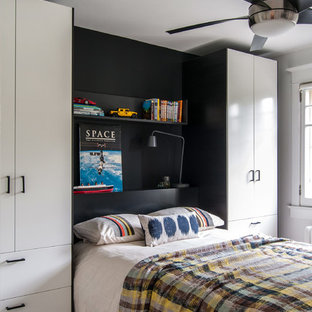 Photo of a contemporary bedroom in Toronto with black walls.