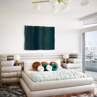 This is an example of a contemporary bedroom in London with white walls.