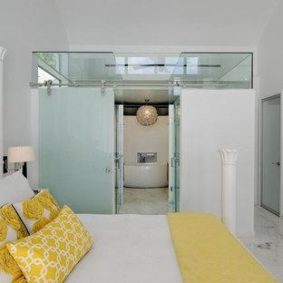 Bedroom - contemporary bedroom idea in Miami with white walls