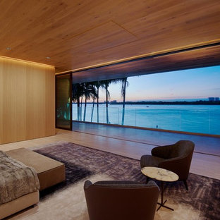 Design ideas for a contemporary bedroom in Miami with beige walls and beige floors.