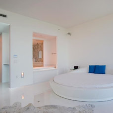 Contemporary Bedroom by Catherine Condoroussis Design