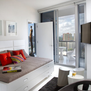 Example of a trendy guest bedroom design in Miami with white walls and no fireplace