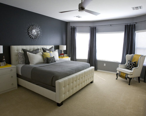 Contemporary bedroom in Salt Lake City with black walls and carpet.
