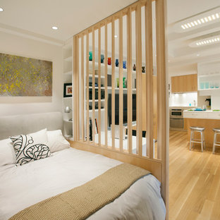 Bedroom - small scandinavian master light wood floor and brown floor bedroom idea in New York with white walls and no fireplace