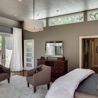 Inspiration for a large midcentury modern master medium tone wood floor bedroom remodel in San Francisco with gray walls
