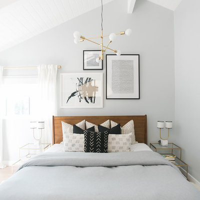 Inspiration for a large scandinavian master light wood floor bedroom remodel in Orange County with gray walls and no fireplace