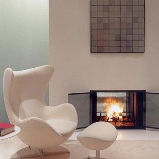 Immagine di una camera matrimoniale moderna di medie dimensioni con pareti bianche, moquette, camino bifacciale, cornice del camino in intonaco e pavimento bianco