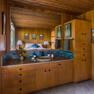 Example of a small mid-century modern guest carpeted, wood ceiling and wood wall bedroom design in Portland