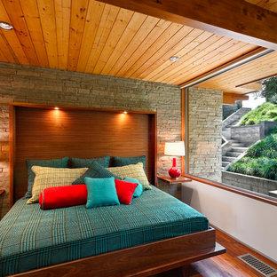 Bedroom - 1950s dark wood floor bedroom idea in Santa Barbara with white walls