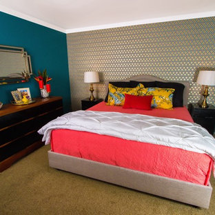 Inspiration for a mid-sized eclectic master carpeted bedroom remodel in Orange County with no fireplace