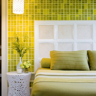 This is an example of a midcentury master bedroom in New York with green walls and dark hardwood floors.