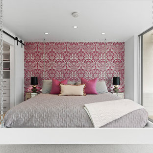 Inspiration for a midcentury master bedroom in Los Angeles with pink walls and grey floors.