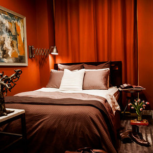 Trendy bedroom photo in New York with red walls