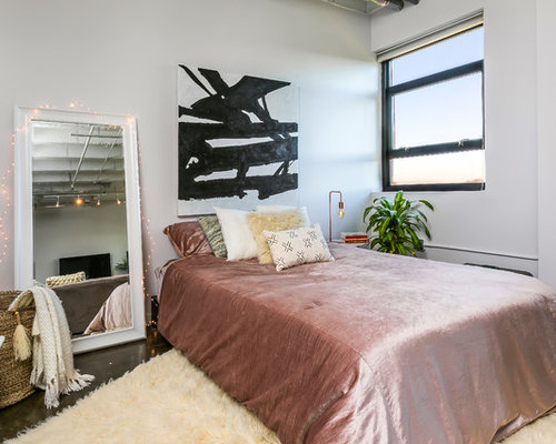 Mauve Bedroom. Example of a mid sized eclectic loft style concrete floor bedroom design in  Atlanta Mauve Bedroom Ideas And Photos Houzz