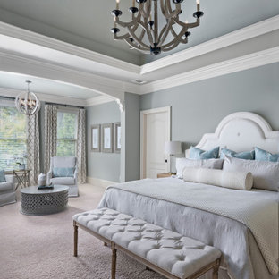 Example of a large tuscan master carpeted and gray floor bedroom design in Atlanta with blue walls