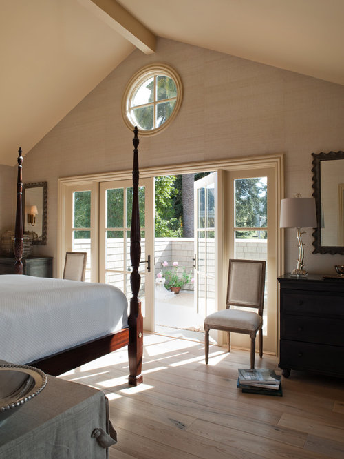 Traditional Medium Tone Wood Floor Bedroom Idea In San Francisco With Beige  Walls