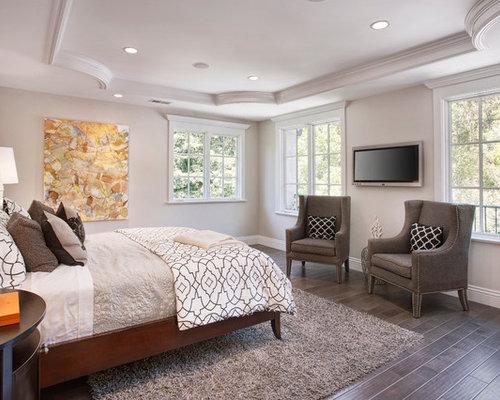 example of a classic bedroom design in san francisco with gray walls dark hardwood floors
