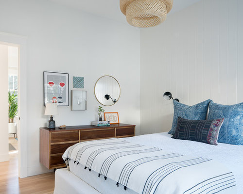 inspiration for a light wood floor and beige floor bedroom remodel in san francisco with