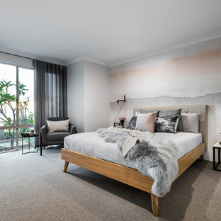 Photo of a mid-sized contemporary master bedroom in Perth with grey walls, carpet and grey floor.