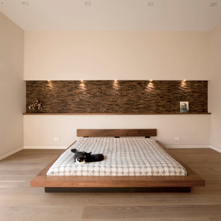 Inspiration for a mid-sized contemporary master medium tone wood floor and brown floor bedroom remodel in Chicago with beige walls
