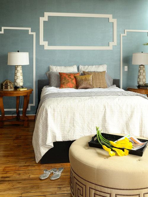 example of a minimalist bedroom design in minneapolis with blue walls and medium tone hardwood floors - Design Of Bedroom Walls