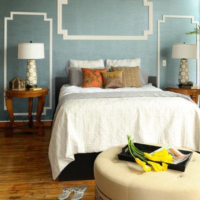 Example of a minimalist medium tone wood floor bedroom design in Minneapolis with blue walls