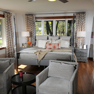Example Of A Large Transitional Master Dark Wood Floor And Brown Bedroom Design In Other