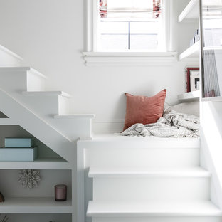 Inspiration for a mid-sized transitional guest medium tone wood floor and brown floor bedroom remodel in Louisville with white walls