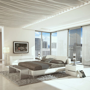 Example of a large trendy porcelain floor bedroom design in Miami with white walls