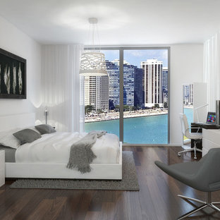 Inspiration for a modern bedroom remodel in Miami with white walls