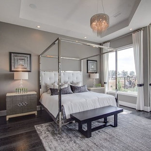 Inspiration for a transitional dark wood floor bedroom remodel in Houston with gray walls