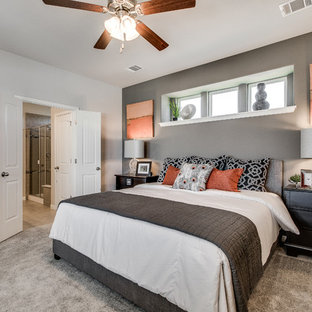 This is an example of a contemporary master bedroom in Austin with grey walls and carpet.