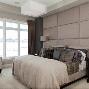 Photo of a large transitional master bedroom in Toronto with beige walls, carpet, beige floor and recessed.