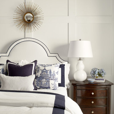 Inspiration for a timeless bedroom remodel in Other with white walls