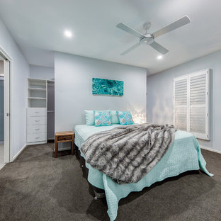 This is an example of a mid-sized contemporary master bedroom in Sunshine Coast with grey walls, carpet and grey floor.