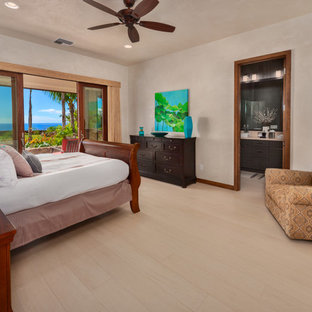 Bedroom - mid-sized tropical master porcelain floor bedroom idea in Hawaii with white walls