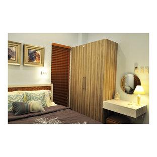 Foto de habitación de invitados de estilo zen, pequeña, con paredes azules y suelo de baldosas de porcelana