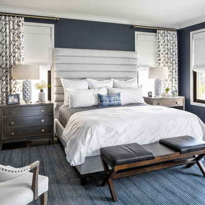 Transitional bedroom photo in New York with blue walls