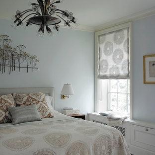 Bedroom - modern bedroom idea in New York with blue walls