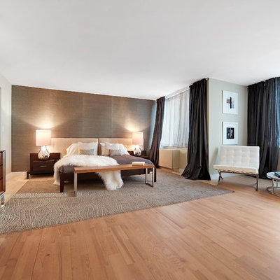 Inspiration for a contemporary light wood floor bedroom remodel in New York with gray walls