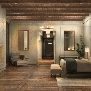 他の地域の大きいコンテンポラリースタイルのおしゃれな主寝室 (グレーの壁、無垢フローリング、両方向型暖炉、コンクリートの暖炉まわり、茶色い床) のレイアウト
