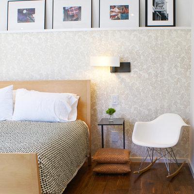 Minimalist dark wood floor bedroom photo in Austin with beige walls