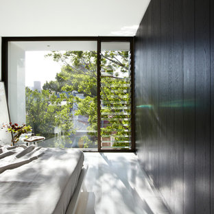 Photo of a contemporary bedroom in Sydney with black walls.