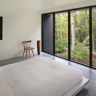 Modern bedroom in Other with white walls.