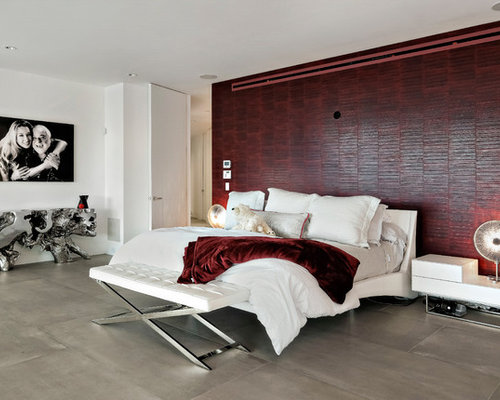 Example of a trendy master gray floor bedroom design in Miami with red walls